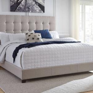 beige linen bed