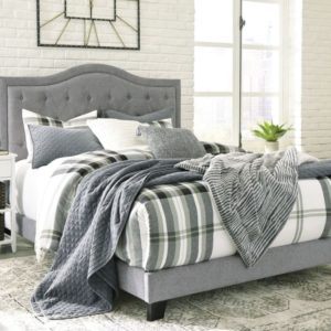 grey linen tufted bed
